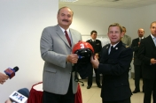 Handing over the fire helmets to the municipal unit of the National Fire Brigade (2004)