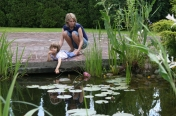 Nina with her Mum by the pond, June 2009